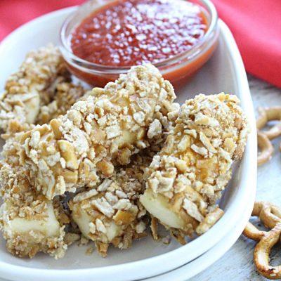 Baked Pretzel Crusted Mozzarella Sticks #pretzel #mozzarella #stringcheese #cheese #cheesesticks #tableforsevenblog