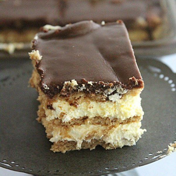 Chocolate Eclair Cake- Table for Seven #tableforsevenblog #chcoolateeclair #cake #nobake #dessert